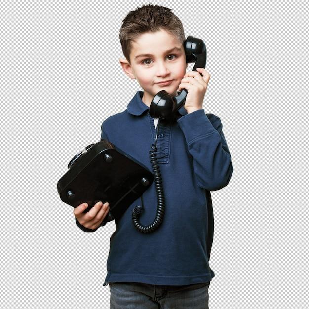 Ragazzino che chiama con il telefono Psd Premium