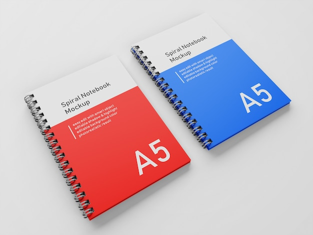 Realistico double corporate a5 hardcover spirale binder notebook mock up modello di progettazione fianco a fianco in 3/4 vista prospettica Psd Premium