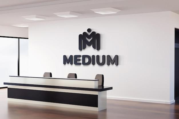 Realistisch zwart logo mockup teken office witte muur Premium Psd