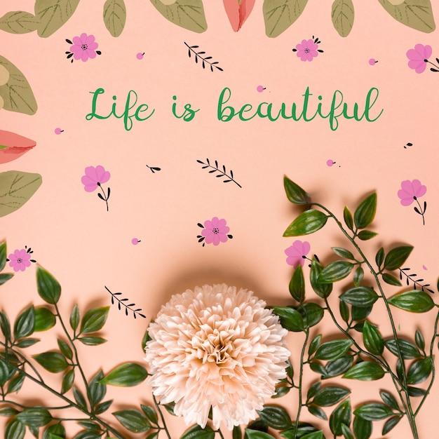 Realistische bladeren en bloemen op papier Gratis Psd