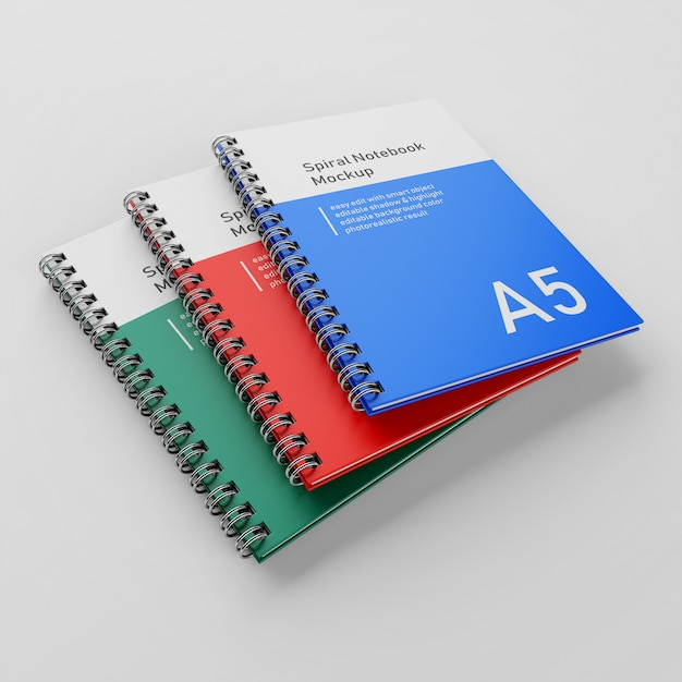 Realistische drie corporate hard cover metalen spiraal a5 binder notebook mock up ontwerpsjabloon in perspectief bekijk Premium Psd
