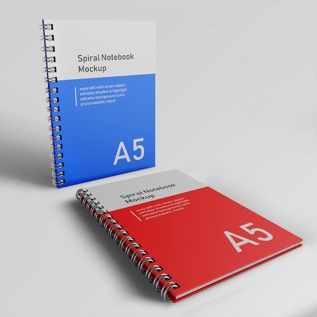 Realistische twee kantoor harde kaft spiraal binder notepad mock up ontwerpsjabloon permanent en rust aan de voorkant perspectief bekijk Premium Psd
