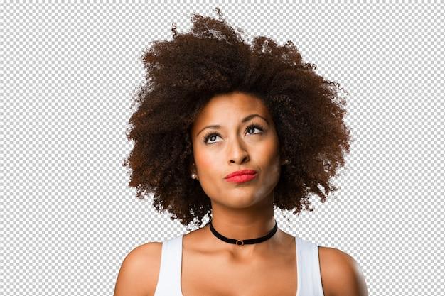 Ritratto di una giovane donna di colore pensando Psd Premium