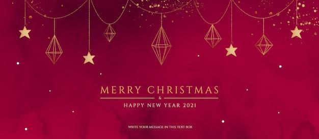 Rode en gouden kerstbanner met elegante versieringen Gratis Psd