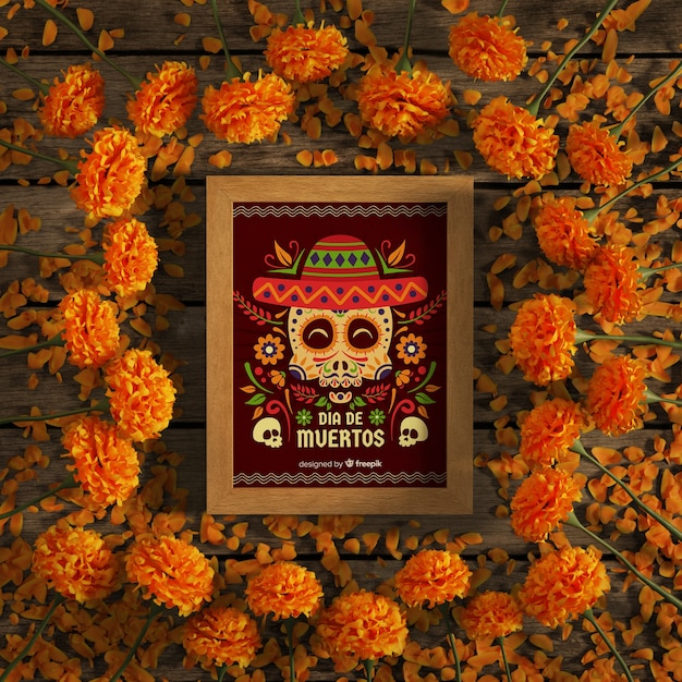 Rode schedel mock-up frame omgeven door oranje bloemen Gratis Psd