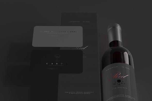Rode wijnfles met doos en model voor visitekaartjes Premium Psd