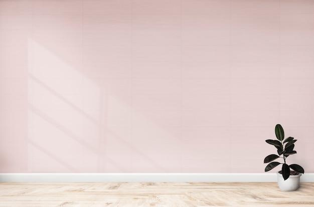 Rubbervijg in een roze ruimte Gratis Psd