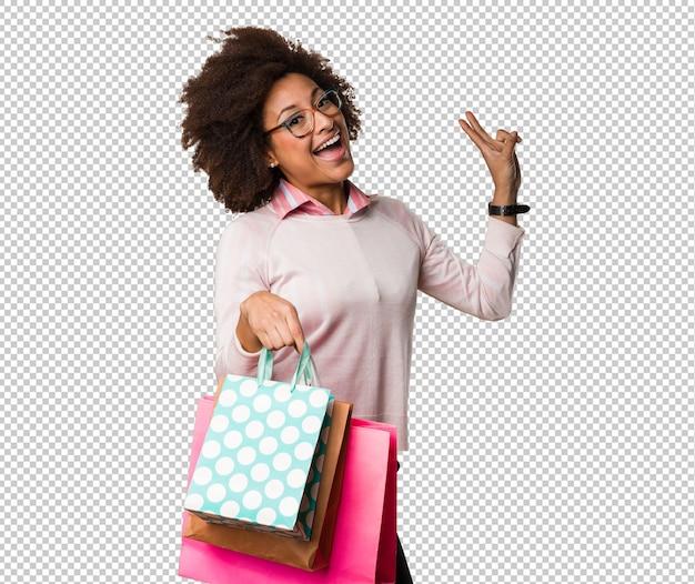 Sacchetti della spesa della tenuta della donna di colore Psd Premium