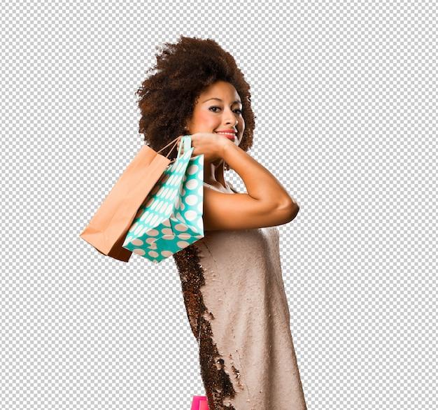 Sacchetti della spesa della tenuta della giovane donna di colore Psd Premium
