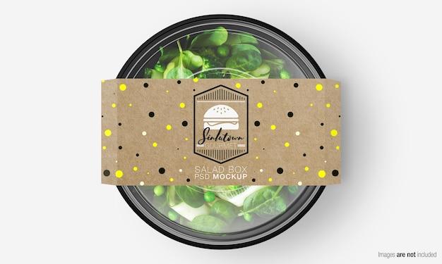 Salade doos mockup met papieren omslag op groene salade Premium Psd