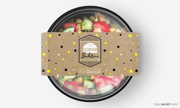 Salade doos mockup met papieren omslag op mix salade Premium Psd