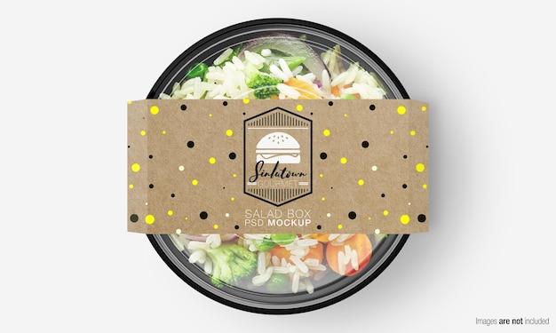 Salade doos mockup met papieren omslag op plantaardige rijst Premium Psd