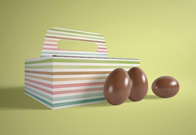 Scatola di cartone animato ad alto angolo con uova di cioccolato Psd Gratuite