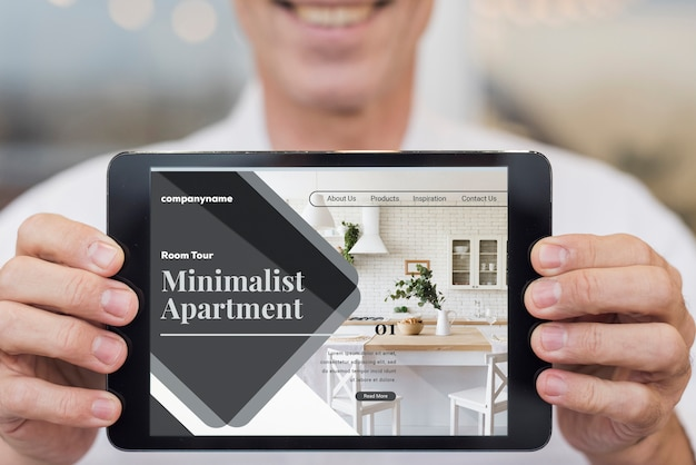 Sitio web minimalista de apartamentos con maqueta de tableta PSD gratuito
