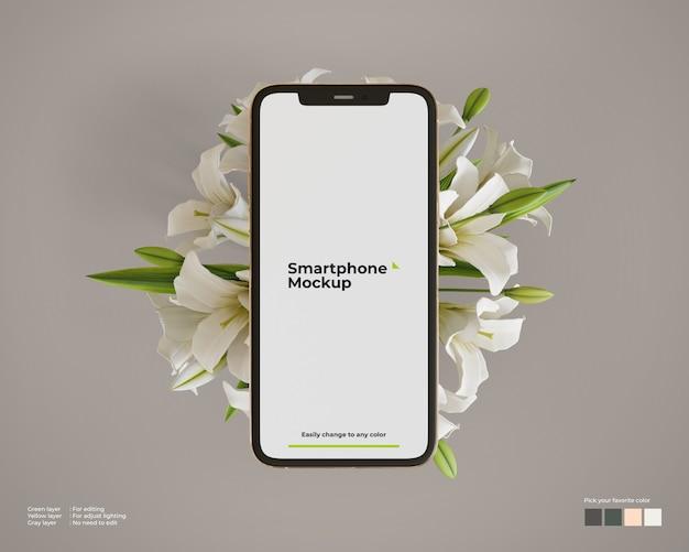 Smartphone-mockup boven bloemen Premium Psd