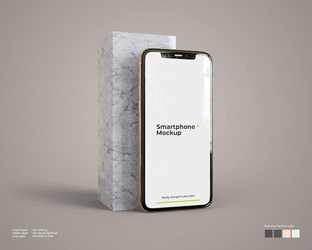 Smartphone-mockup met marmeren blok Premium Psd
