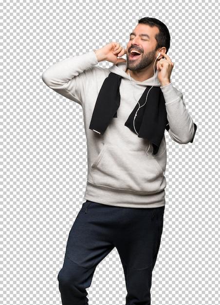 Sport man luisteren naar muziek met een koptelefoon Premium Psd