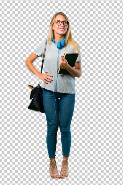Studentenmeisje met glazen die met wapens bij heup en het lachen stellen Premium Psd