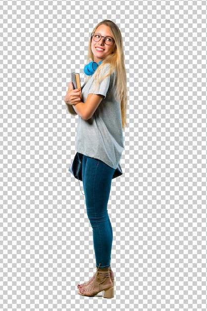 Studentenmeisje met glazen in zijpositie terwijl het kijken over de schouder met een glimlach Premium Psd