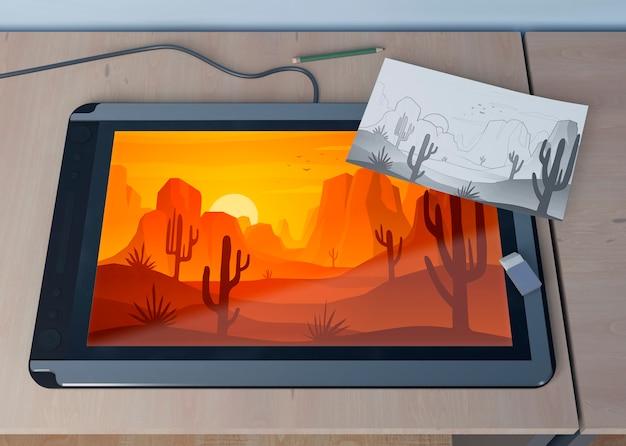 Tablet met landschap en bladschets Gratis Psd