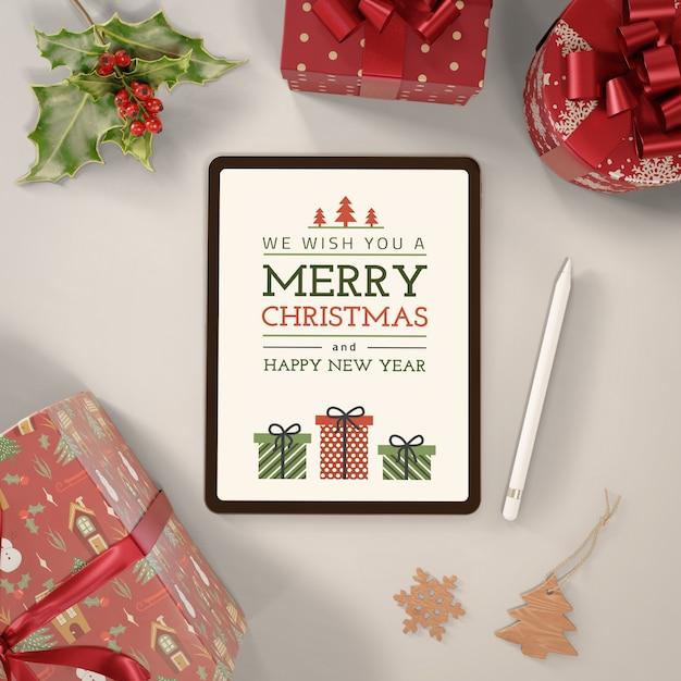 Tableta con mensaje de feliz navidad PSD gratuito