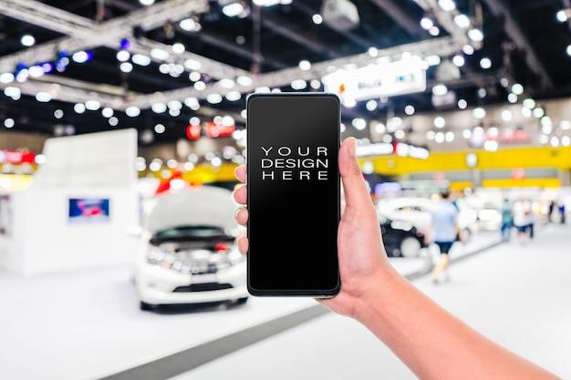 Telefono cellulare con auto astratto sfocato mostra mostra Psd Premium