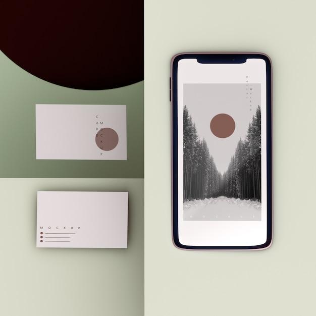 Teléfono de marca de escena plana y maqueta de tarjeta de visita PSD gratuito
