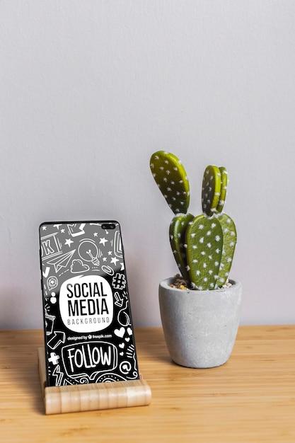 Telefono mock-up con il concetto di social media Psd Gratuite