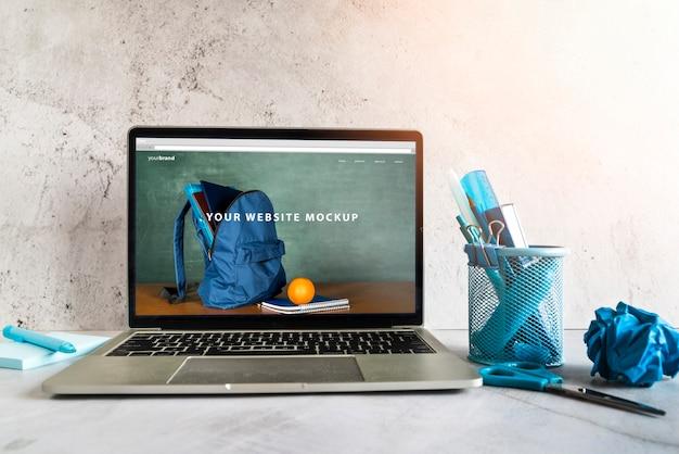 Terug naar school items met website mock-up Gratis Psd