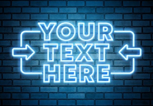 Texto de neón azul en maqueta de pared de ladrillo PSD Premium