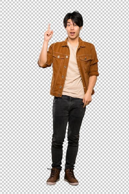 Un colpo integrale di un uomo asiatico con giacca marrone che intende realizzare la soluzione sollevando un dito Psd Premium