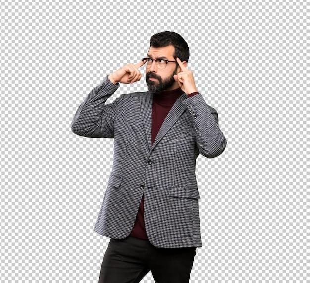 Uomo bello con i vetri che ha dubbi e pensiero Psd Premium