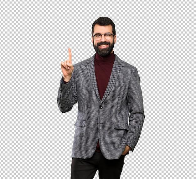 Uomo bello con i vetri che mostra e che solleva un dito nel segno del meglio Psd Premium