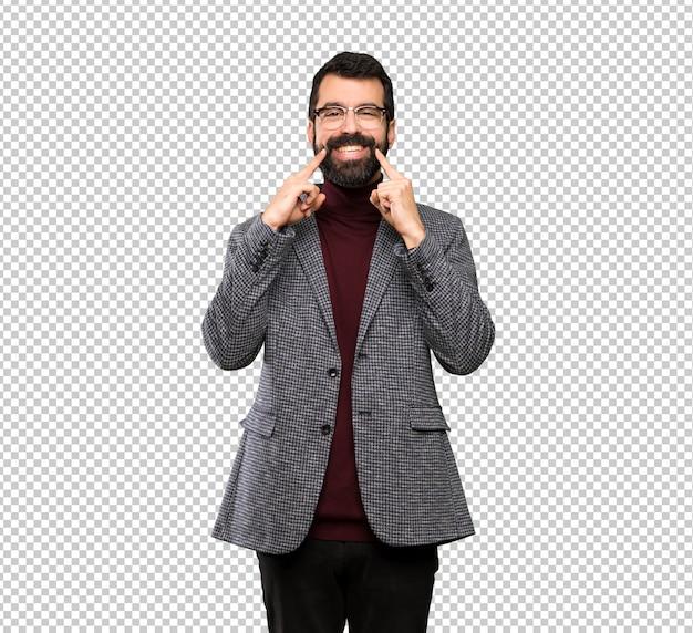 Uomo bello con i vetri che sorride con un'espressione felice e piacevole Psd Premium