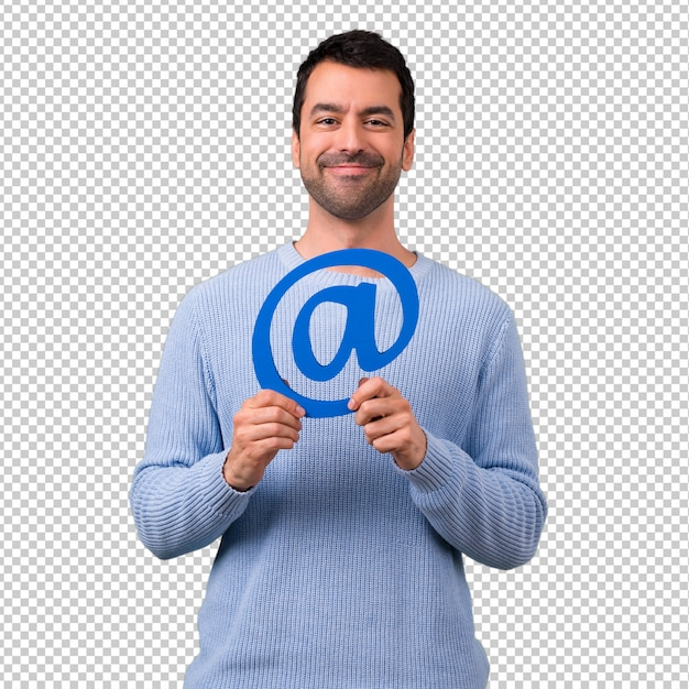Uomo con l'icona della holding del maglione blu di dot com Psd Premium