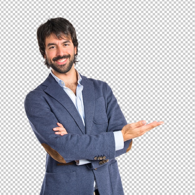 Uomo d'affari che presenta qualcosa sopra fondo bianco isolato Psd Premium