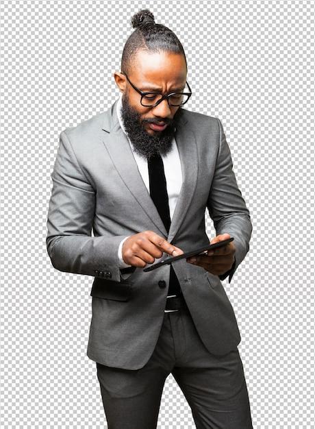 Uomo di affari nero con un tablet Psd Premium