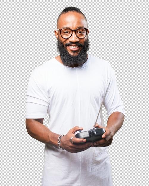 Uomo di colore che gioca con un telecomando dell'automobile Psd Premium