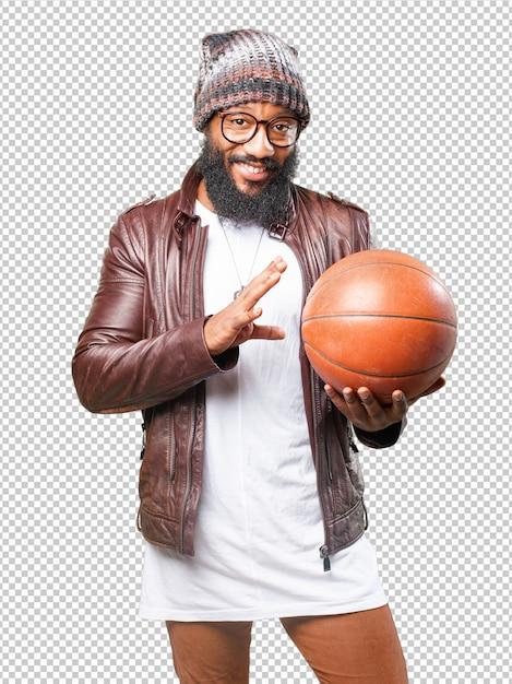 Uomo di colore che gioca con una palla da basket Psd Premium