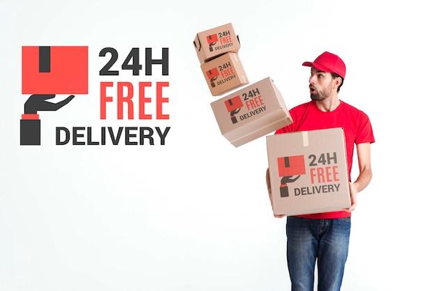Uomo di consegna gratuito non-stop con scatole cadute Psd Gratuite
