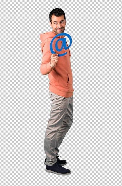 Uomo in un'icona di tenuta della maglietta felpata rosa di dot com Psd Premium