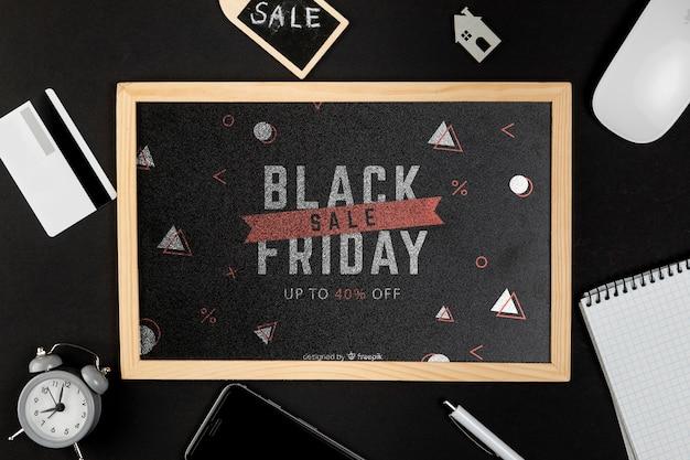 Venerdì nero concetto mock-up su sfondo nero Psd Gratuite
