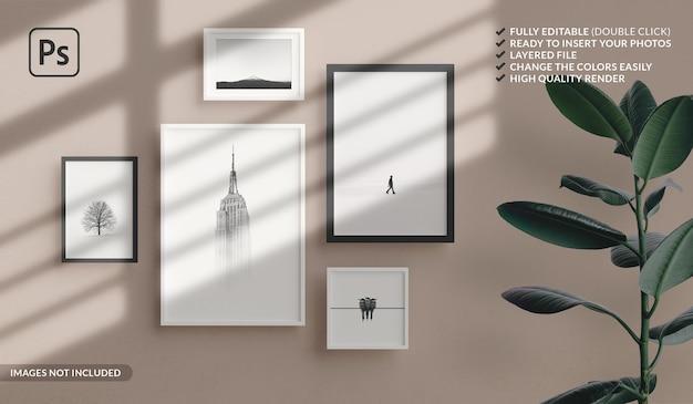 Verschillende formaten van minimale fotolijsten mockup die aan de muur van het appartement hangen Premium Psd