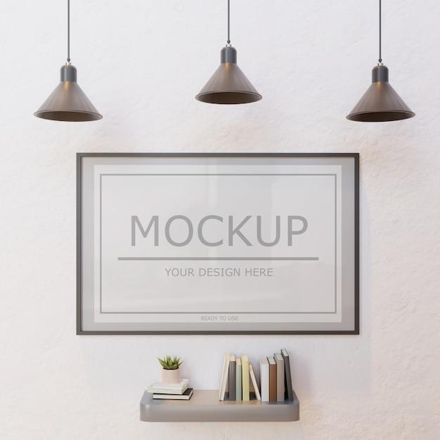 Verticaal kadermodel op witte muur onder lamp met boekenmuurplank Premium Psd