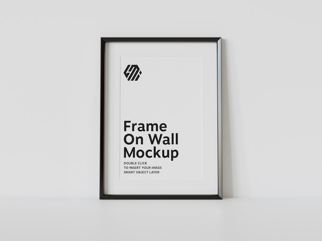 Verticaal zwart frame dat op vloermodel leunt Premium Psd