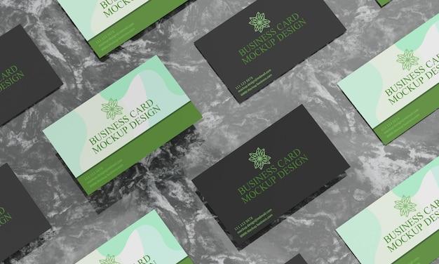 Visitekaartjes op zwart marmeren tafelmodel Premium Psd