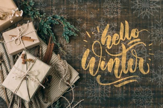 Vista dall'alto ciao inverno con scatole regalo bianche Psd Gratuite