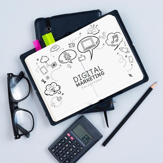 Vista dall'alto di calcolatrice e notebook Psd Gratuite