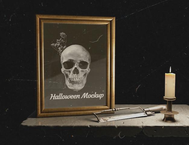 Vista frontale halloween mock-up cornice con teschio Psd Gratuite