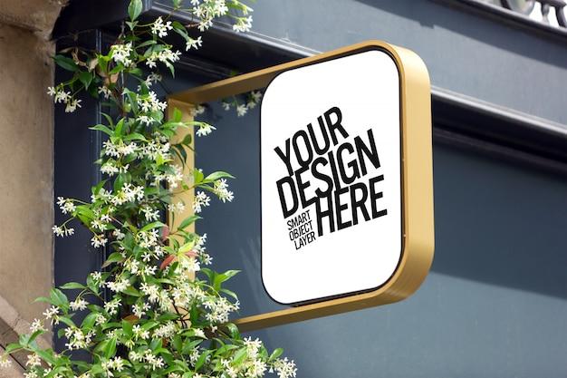 Vista de un letrero de edificio en la maqueta de la calle PSD Premium